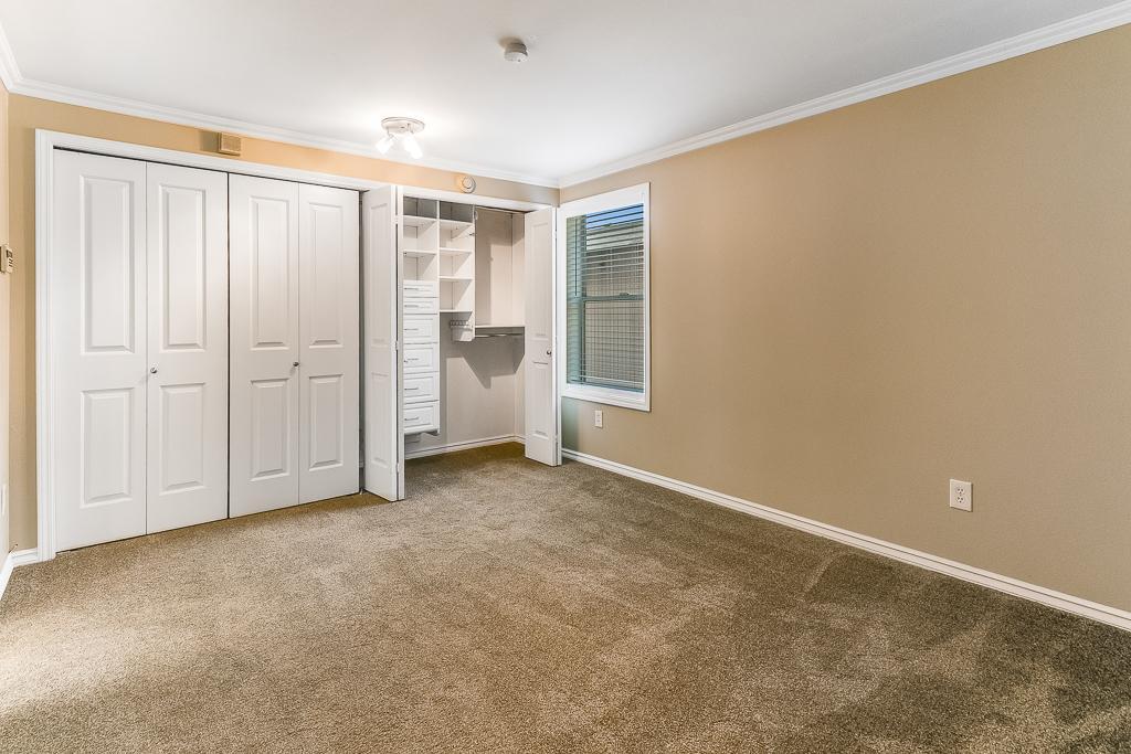 Primary bedroom with double closet & Bath