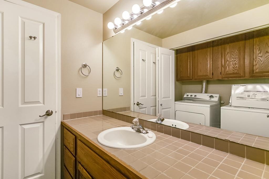 Full size washer & dryer in hall bathroom.