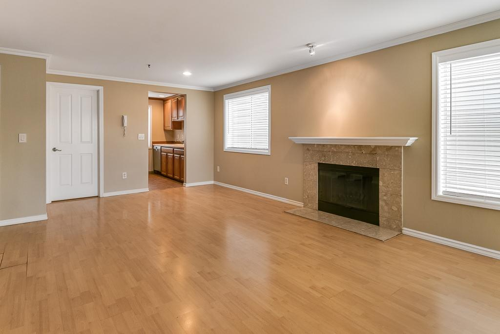 Living/Dining area with wood burning fireplace